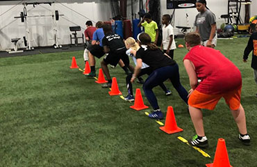 Introductory Youth Speed and Agility Group Classes for boys and girls to help prepare them for any sports or athletic event at Kansas City Athlete Training in Kansas City Missouri